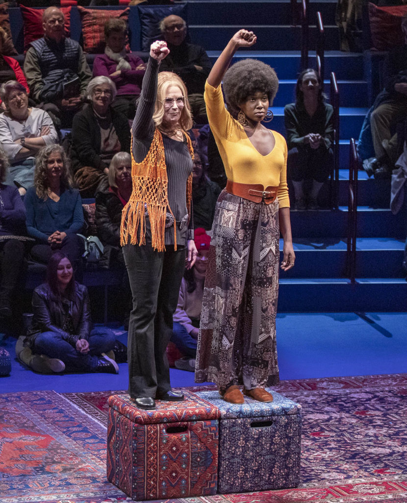 """Patricia Kalember as Gloria Steinem (left) and Gabrielle Beckford as Dorothy Pitman Hughes reenact an iconic 1971 Esquire magazine photo in """"Gloria: A Life"""" at American Repertory Theater, Cambridge. (APrioriPhotography.com)"""
