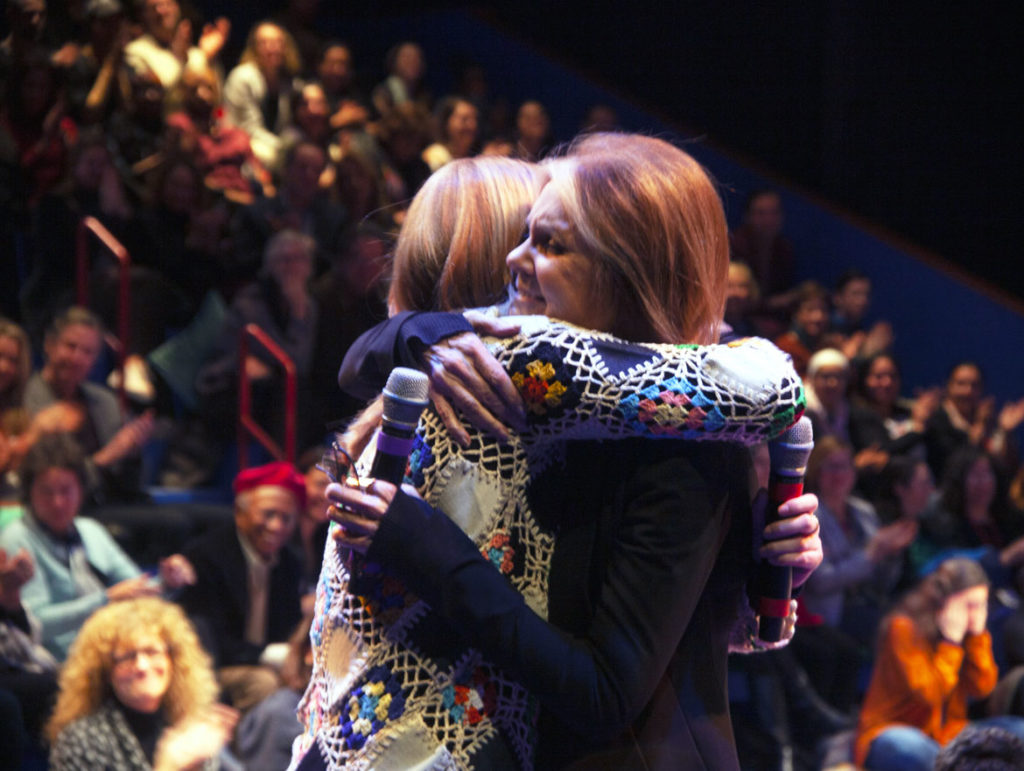 """Gloria Steinem embraces an audience member after she spoke at """"Gloria: A Life"""" at American Repertory Theater, Cambridge, Jan. 30, 2020. (Photo: Liv Slaughter/Chris Rogers)"""