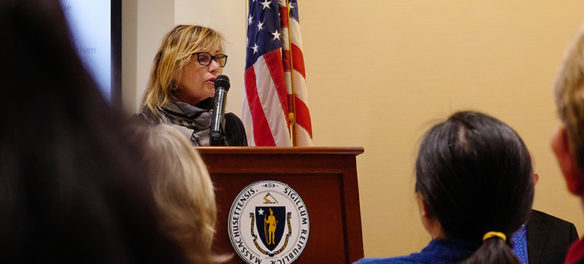 Anita Walker speaking at a podium at the State House. (Photo: Mass Cultural Council / Timothea Pham)