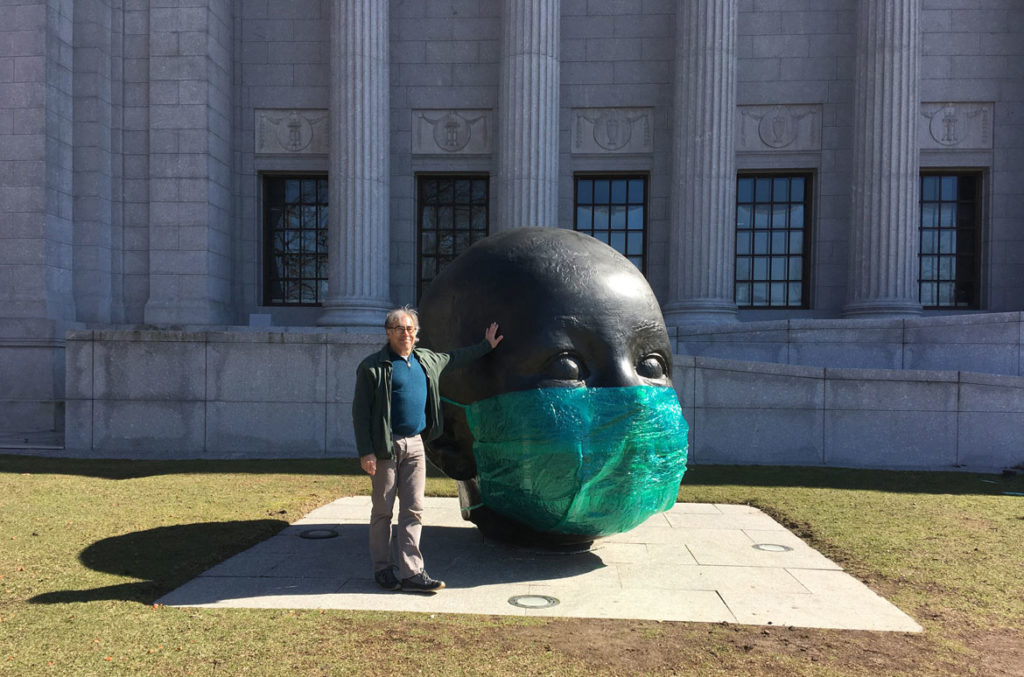 "Peter Agoos with his guerrilla art installation ""PPE for Antonio López Garcia's 'DAY'"" at Boston's Museum of Fine Arts, March 22, 2020. (Courtesy Peter Agoos)"