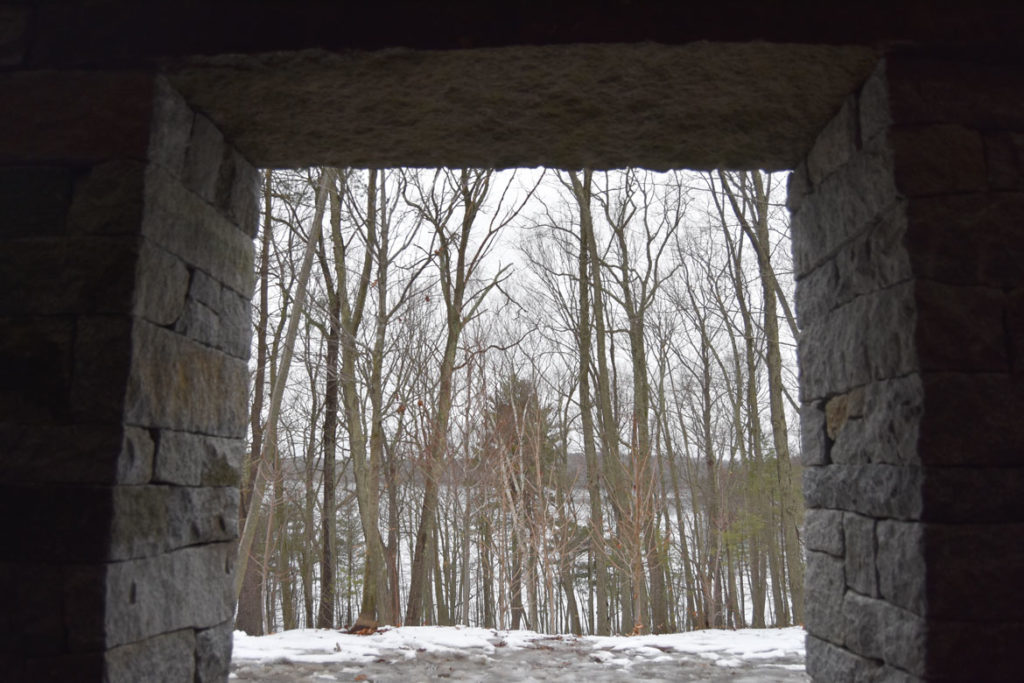 "Looking out from inside Andy Goldsworthy's ""Watershed"" toward Flint's Pond, Jan. 25, 2020. (Greg Cook photo)"