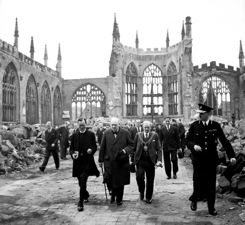 British Prime Minister Winston Churchill walks through the ruined nave of Coventry Cathedral, England, after it was devastated in the Coventry Blitz of Nov. 14 to 15, 1940. (United Kingdom Government / Public Domain)