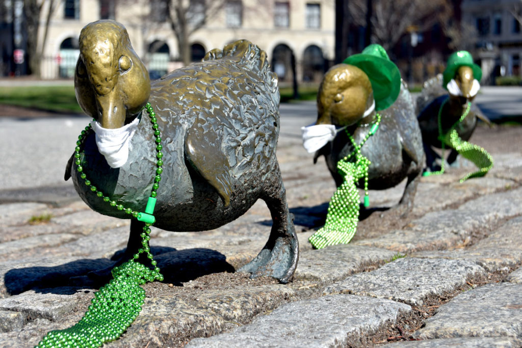 "Nancy Schon's 1987 ""Make Way for Ducklings"" statues wear masks to protect them from coronavirus at Boston Public Garden, March 22, 2020. (Greg Cook photo)"