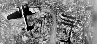 During World War II, a German Luftwaffe Heinkel He 111 bomber flys over the East End of London at the start of the Luftwaffe's evening raids on Sept. 7, 1940. (German Air Force photographer / Public Domain)
