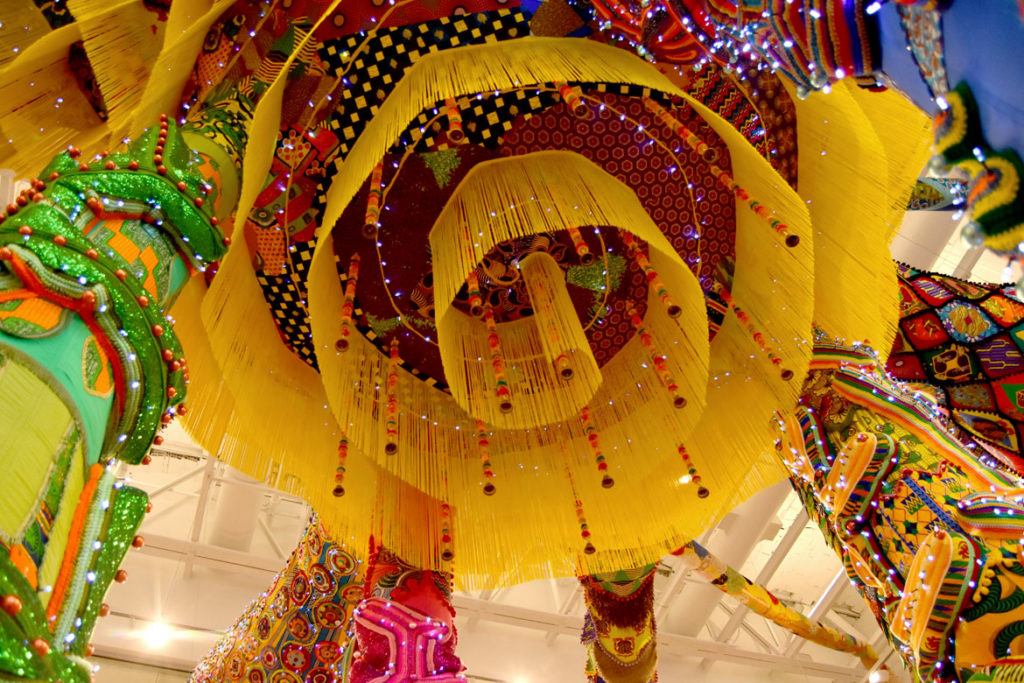 "Looking up into Joana Vasconcelos's ""Valkyrie Mumbet"" the MassArt Art Museum's second floor Paine Gallery, Feb. 25, 2020. (Greg Cook)"
