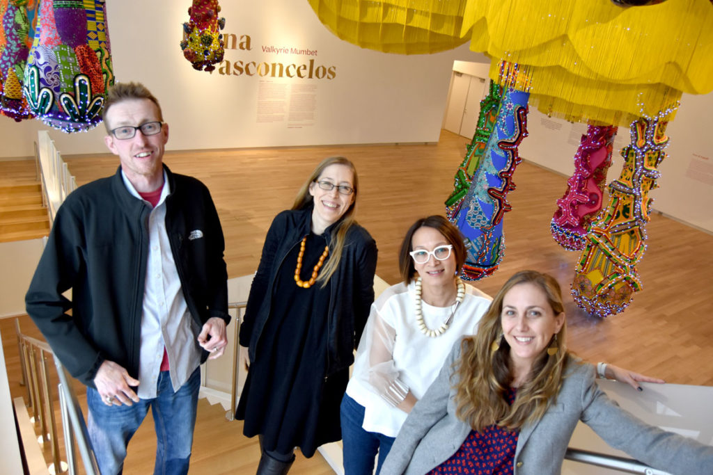 MassArt Art Museum staff include (from left) Chief Preparator Rob Gainfort, Assistant Curator Darci Hanna Executive Director Lisa Tung and Associate Director Chloé Zaug, Feb. 25, 2020. Not pictured: Museum Coordinator Mariah Azoti and Curator of Education Mesma Belsaré. (Greg Cook)