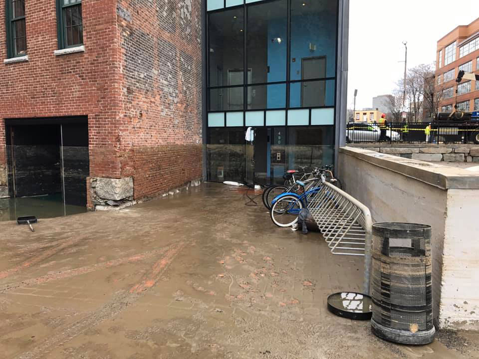 Flood waterline on the back of the red brick building housing Boston Sculptors Gallery, April 16, 2020. (Eric Sealine photo)