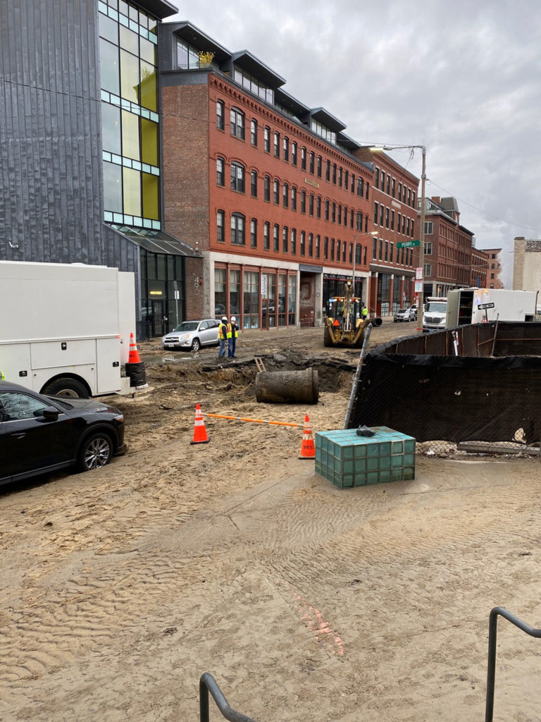 The water main break left a sinkhole in Harrison Avenue and the street covered with mud, April 15, 2020. (Photo courtesy Chris Grimley / Minni)
