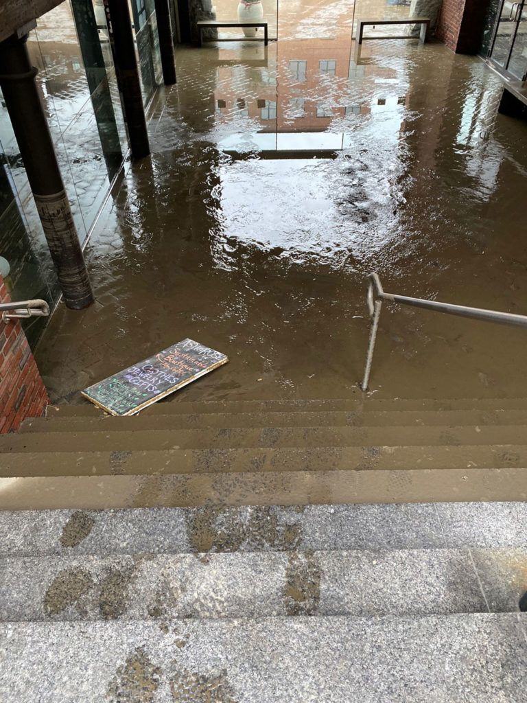 Flooding in 460 Harrison Ave. at the steps down to the parking lot on the other side of the building, April 15, 2020. (Photo courtesy Chris Grimley / Minni)