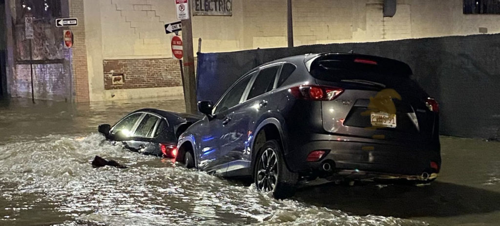 Flooding from a water main break flooded galleries and submerged vehicles along Harrison Avenue at Perry Street in Boston, April 14, 2020. (Boston Fire Department photo)
