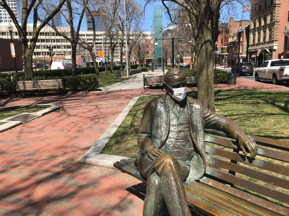A protective mask has appeared on the statue of former Boston mayor James Michael Curley at Congress Street (by Lloyd Lillie, 1979–1980), c. April 6, 2020. (Courtesy)