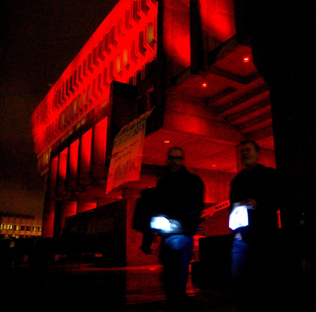 Boston City Hall lit up red for Medicine Wheel's annual AIDS Vigil, Nov. 30, 2016. (Greg Cook photo)