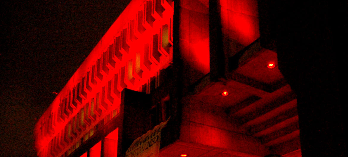Boston City Hall lit up red for Medicine Wheel's annual AIDS Vigil, Nov. 30, 2016. (Greg Cook photo)