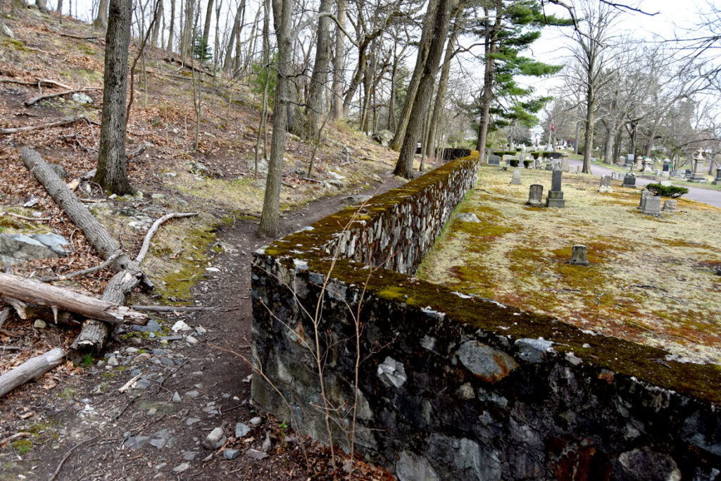 Border wall between Pine Banks Park and Forest Dale Cemetery, Malden, April 20, 2020. (Greg Cook photo)