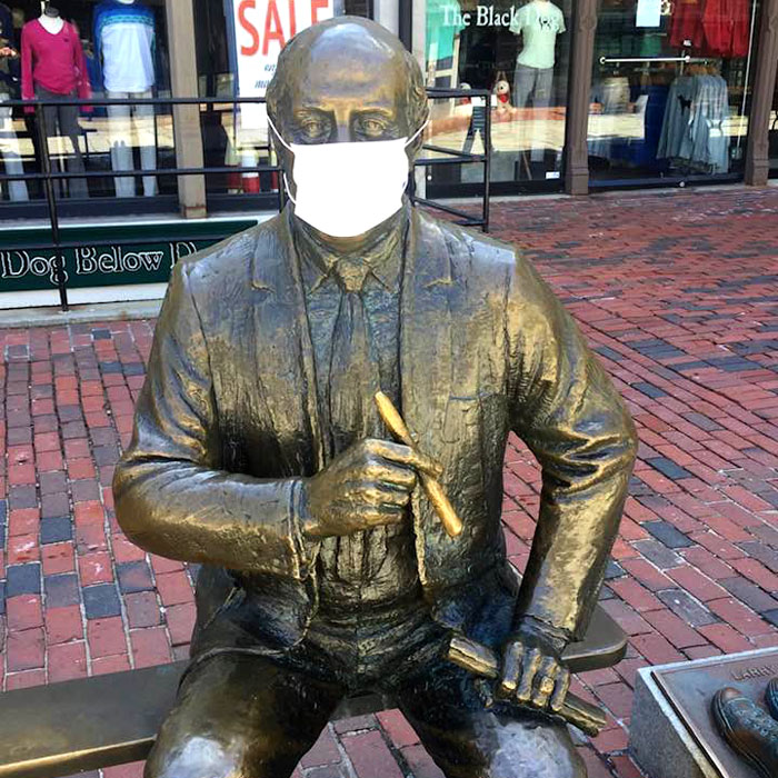 A protective mask has appeared on the 1985 statue of longtime Boston Celtics coach Red Auerbach by Lloyd Lillie outside Quincy Market at Faneuil Hall, c. April 6, 2020. (Courtesy)