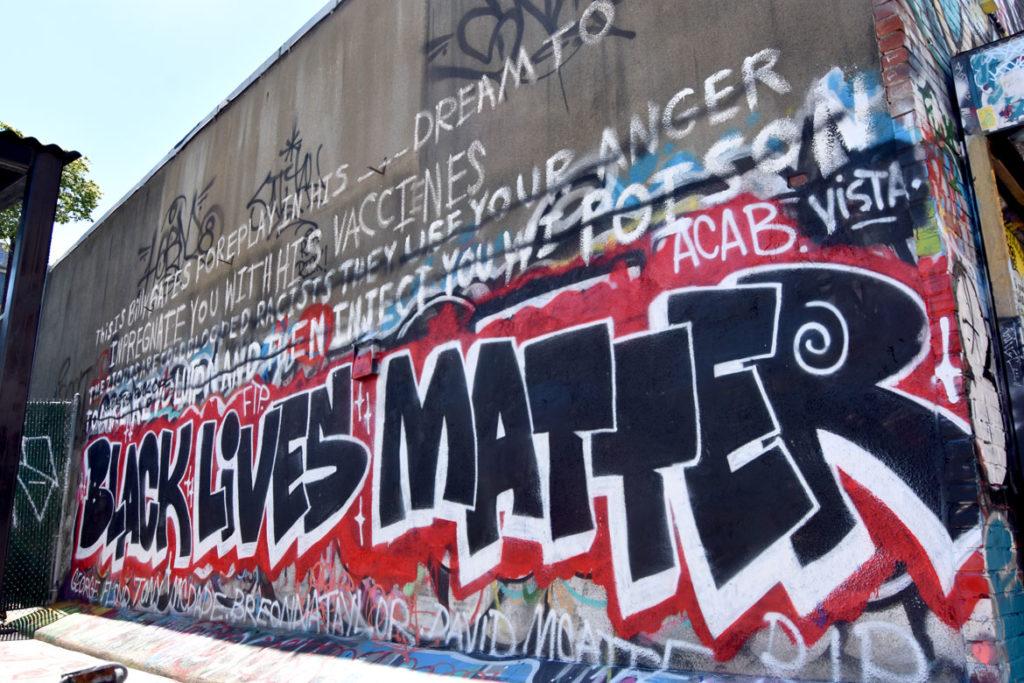 """Black Lives Matter"" mural at Graffiti Alley, Central Square, Cambridge, June 18, 2020. (© Greg Cook photo)"