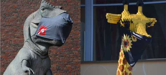 The T-Rex outside Boston's Museum of Science and the Lego giraffe standing in front of Somerville's Legoland Discovery Center now wear a coronavirus masks, June 2020.