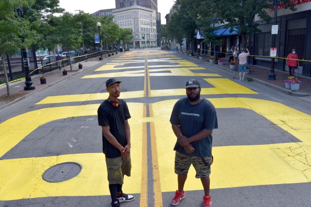 "Paul ""Mar"" Chapman (left) and Lee Beard were lead artists for the ""Black Lives Matter"" street mural on Washington Street in Boston's Nubian Square, July 5, 2020. (© Greg Cook photo)"