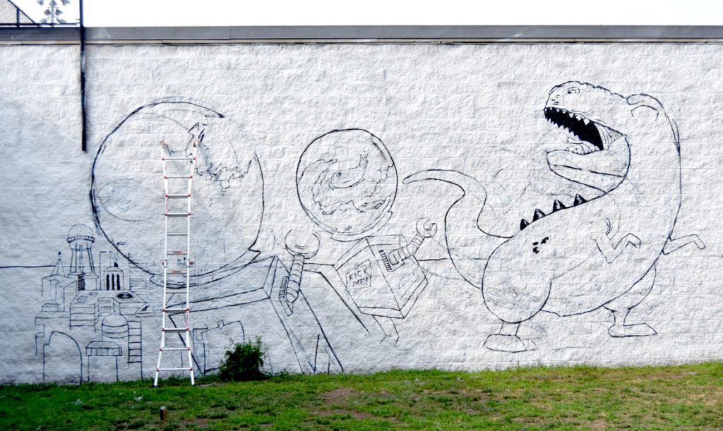 Curtis Williams begins a mural at Boston's Madison Park Technical Vocational High School, July 5, 2020. (© Greg Cook photo)