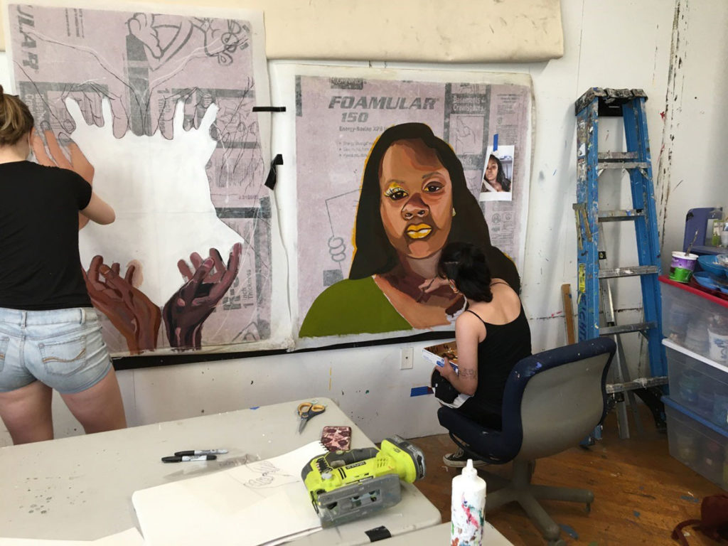 Painting the protest icons. (Courtesy David Fichter)