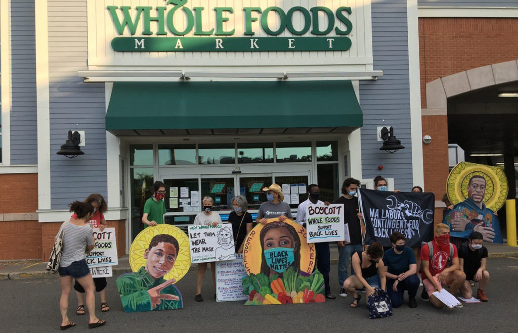 Protest icons at Whole Foods Market in Cambridge, where workers have protested being sent home without pay for wearing Black Lives Matter masks while working at the River Street business. (Courtesy David Fichter)