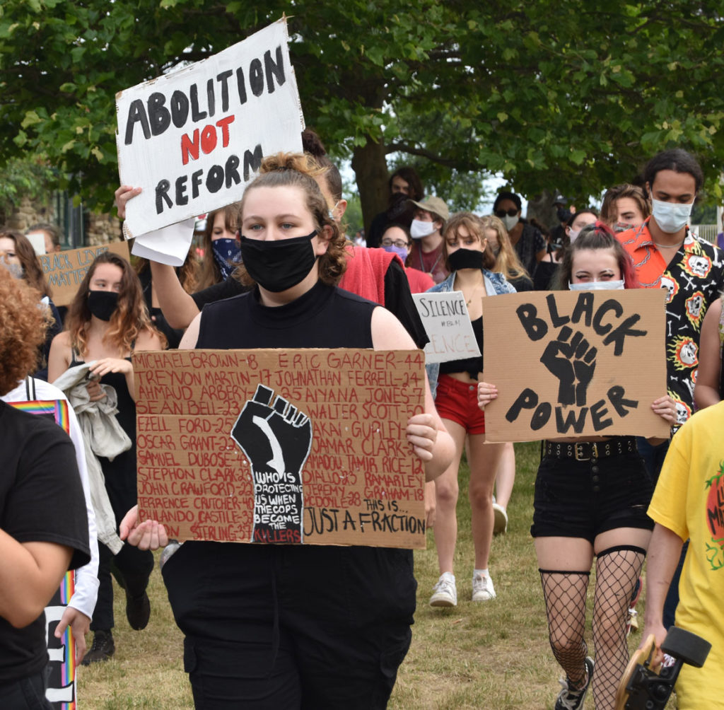 """""""Independence Day March"""" against injustice organized by Demilitarize Gloucester at Gloucester's waterfront, July 4, 2020. (© Greg Cook photo)"""