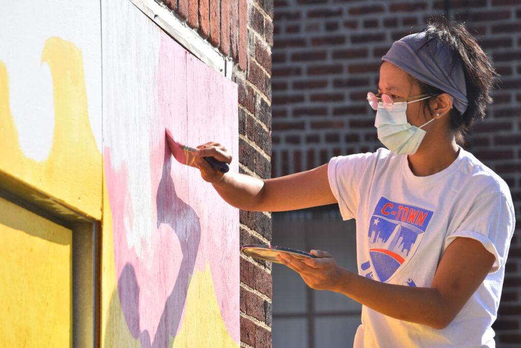 Vivian Ho painting mural at Wah Lum Kung Fu & Thai Chi Academy in Malden, July 19, 2020. (Photo ©Greg Cook)