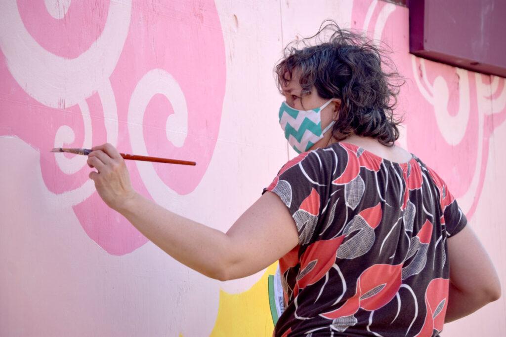 Kari Percival painting mural at Wah Lum Kung Fu & Thai Chi Academy in Malden, July 19, 2020. (Photo ©Greg Cook)