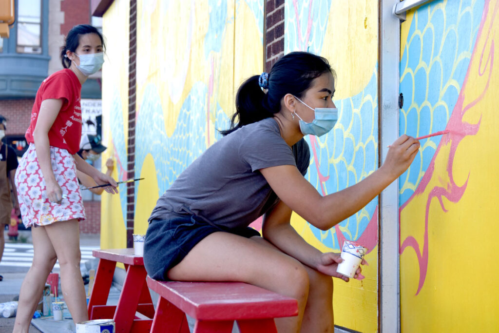 Yen Chit (foreground) and Shaina Lu painting mural at Wah Lum Kung Fu & Thai Chi Academy in Malden, July 25, 2020. (Photo ©Greg Cook)