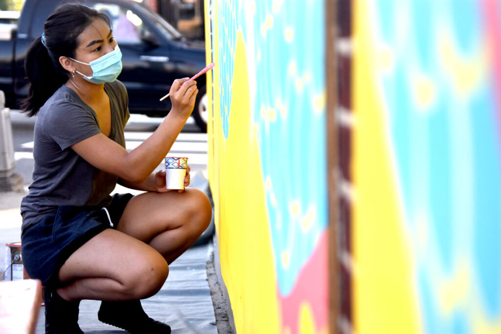 Yen Chit painting mural at Wah Lum Kung Fu & Thai Chi Academy in Malden, July 25, 2020. (Photo ©Greg Cook)