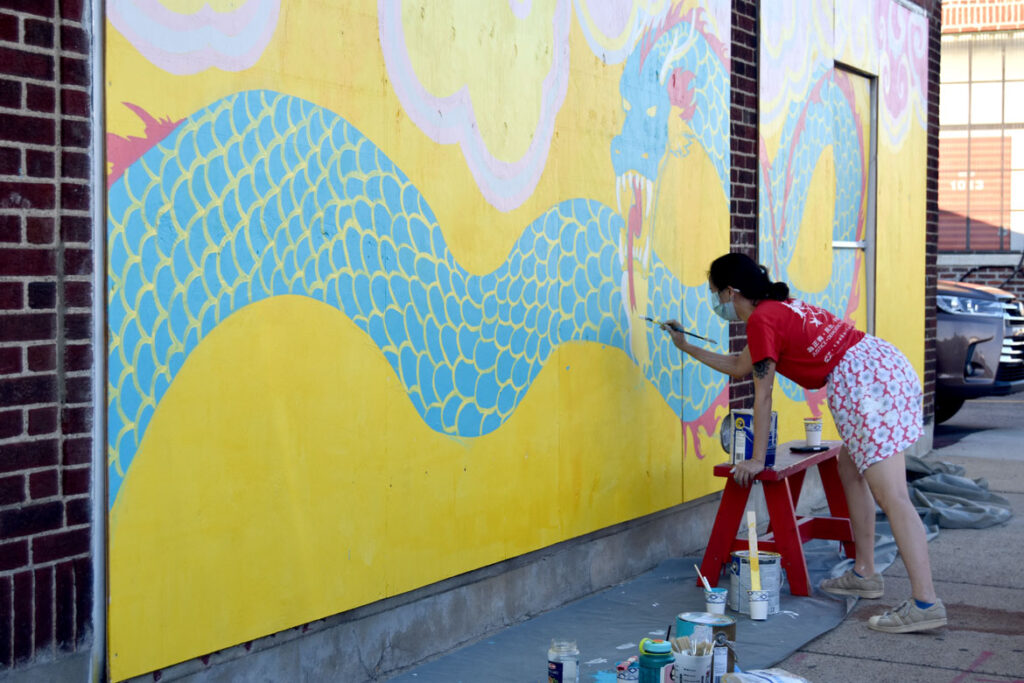 Shaina Lu painting mural at Wah Lum Kung Fu & Thai Chi Academy in Malden, July 25, 2020. (Photo ©Greg Cook)