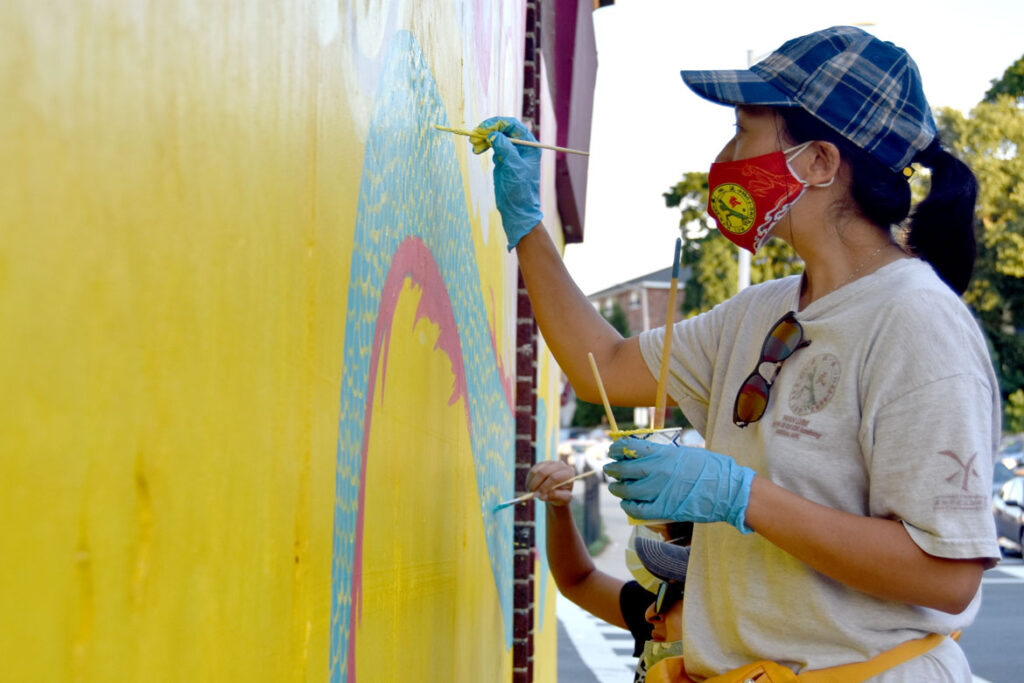 Mai Du painting mural at Wah Lum Kung Fu & Thai Chi Academy in Malden, July 25, 2020. (Photo ©Greg Cook)