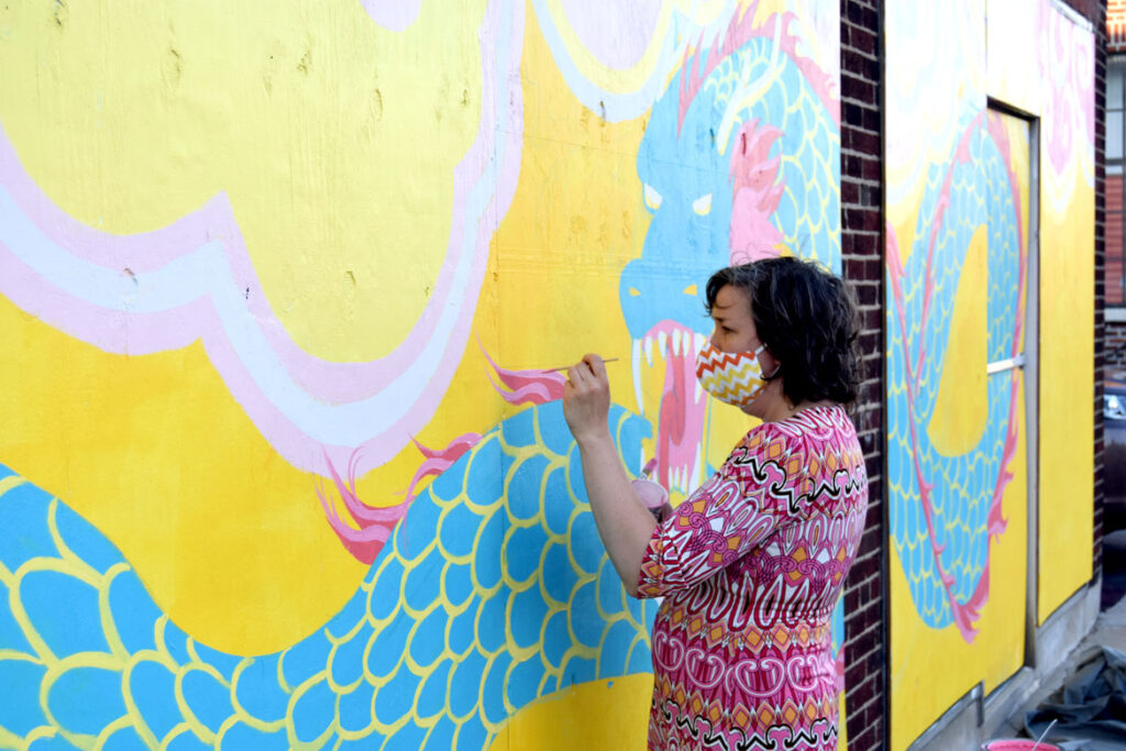 Kari Percival painting mural at Wah Lum Kung Fu & Thai Chi Academy in Malden, July 25, 2020. (Photo ©Greg Cook)
