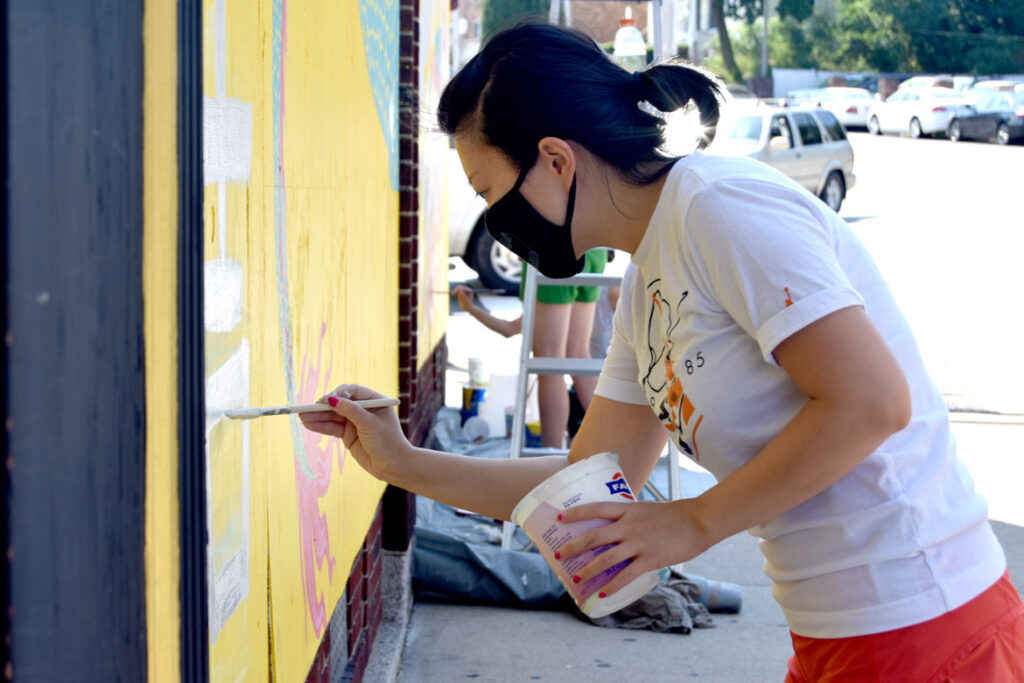Rayna Lo painting mural at Wah Lum Kung Fu & Thai Chi Academy in Malden, July 29, 2020. (Photo ©Greg Cook)