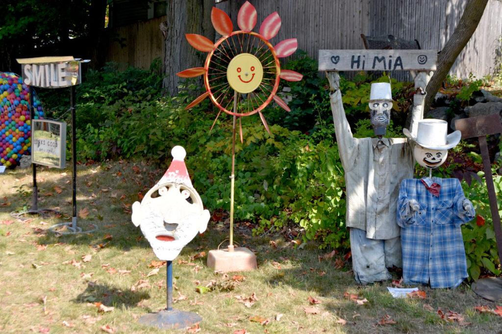 "Raymond Cardogno's ""Hubcap Face,"" ""Spinning Sunflower Wheel,"" ""Hi Mia,"" and ""Gunslinger"" in ""Metal-ity"" at ArtSpace Maynard, Sept. 25, 2020. (© Greg Cook photo)"
