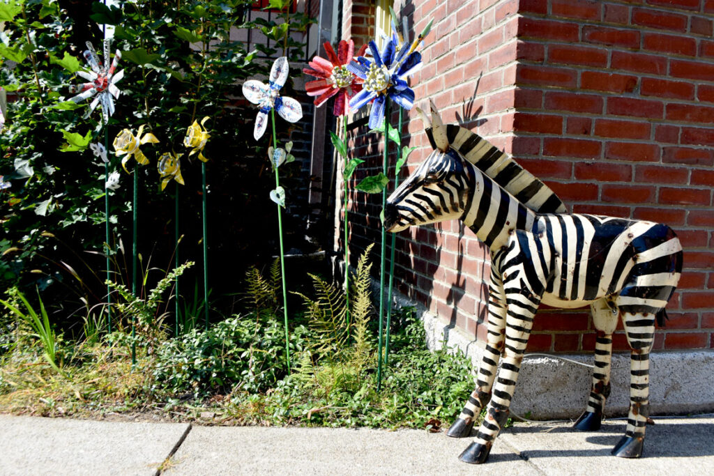 """Margot Slowick's """"Flowers"""" and """"Zebra"""" by an unknown Mexican artist in """"Metal-ity"""" at ArtSpace Maynard, Sept. 25, 2020. (© Greg Cook photo)"""