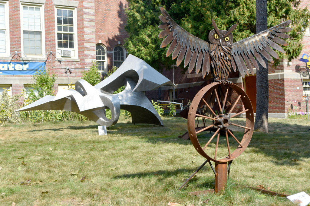 "Joe ""Metal Genius Joe"" Mandarino's ""Owl"" (foreground) and Joseph Ferguson's ""Narwhal"" in ""Metal-ity"" at ArtSpace Maynard, Sept. 25, 2020. (© Greg Cook photo)"