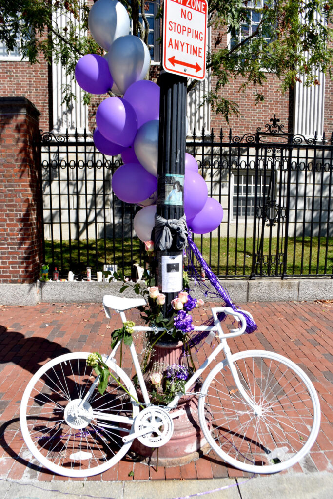 Ghost bike placed in Cambridge's Harvard Square to remember her Darryl Willis, who was fatally struck by a truck there on Aug. 18. Sept. 19, 2020. (© Greg Cook photo)