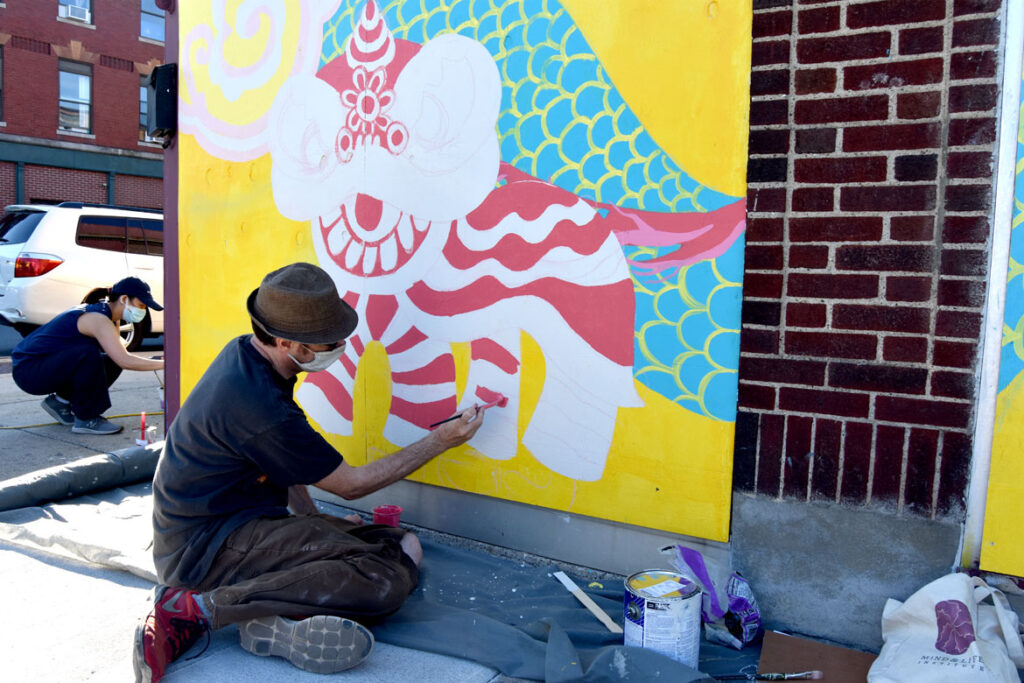 Greg Cook painting mural at Wah Lum Kung Fu & Thai Chi Academy in Malden, Aug. 1, 2020. (Photo ©Greg Cook)