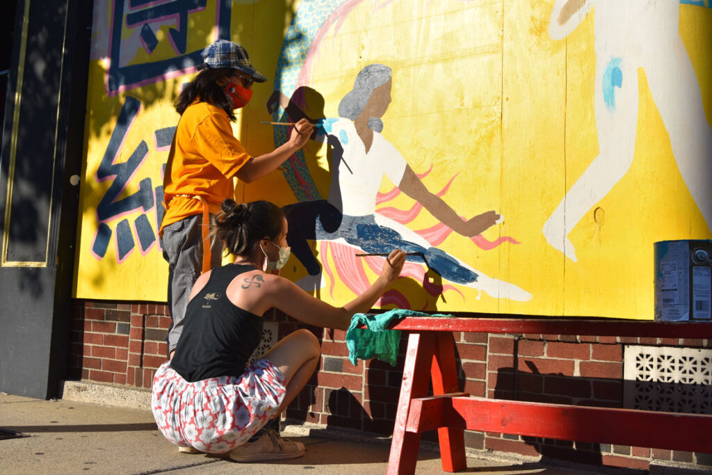 Mai Du (left) and Shaina Lu painting mural at Wah Lum Kung Fu & Thai Chi Academy in Malden, Aug. 1, 2020. (Photo ©Greg Cook)