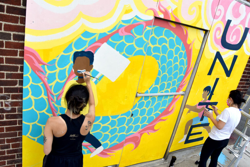 Shaina Lu (left) and Rayna Lo painting mural at Wah Lum Kung Fu & Thai Chi Academy in Malden, Aug. 8, 2020. (Photo ©Greg Cook)