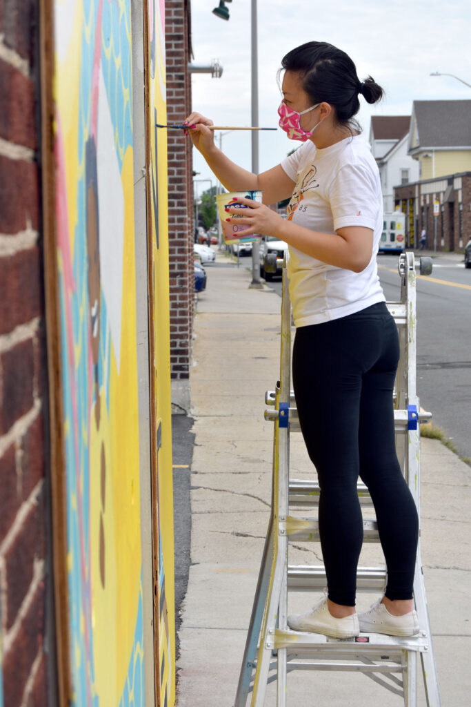 Rayna Lo painting mural at Wah Lum Kung Fu & Thai Chi Academy in Malden, Aug. 8, 2020. (Photo ©Greg Cook)