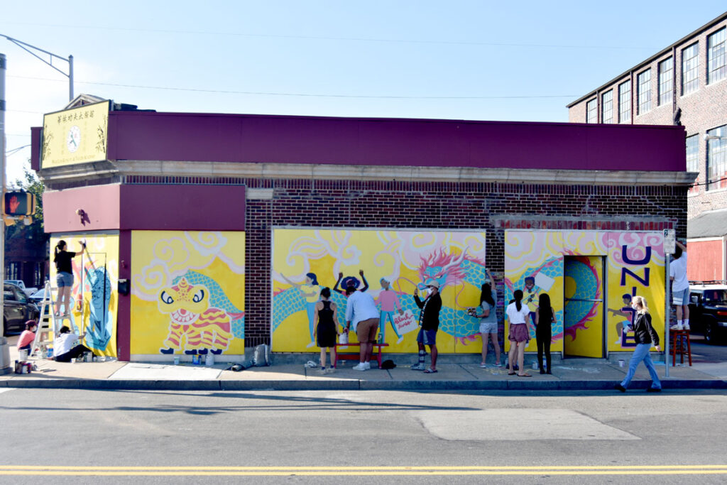 Painting mural at Wah Lum Kung Fu & Thai Chi Academy in Malden, Aug. 8, 2020. (Photo ©Greg Cook)