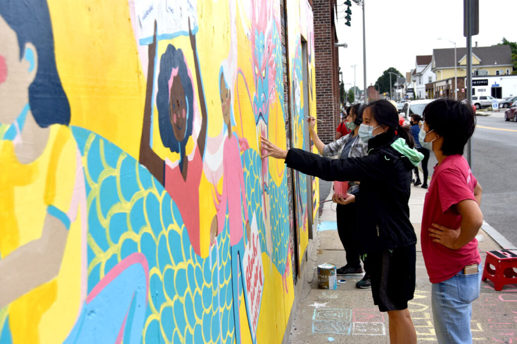 Painting mural at Wah Lum Kung Fu & Thai Chi Academy in Malden, Aug. 15, 2020. (Photo ©Greg Cook)