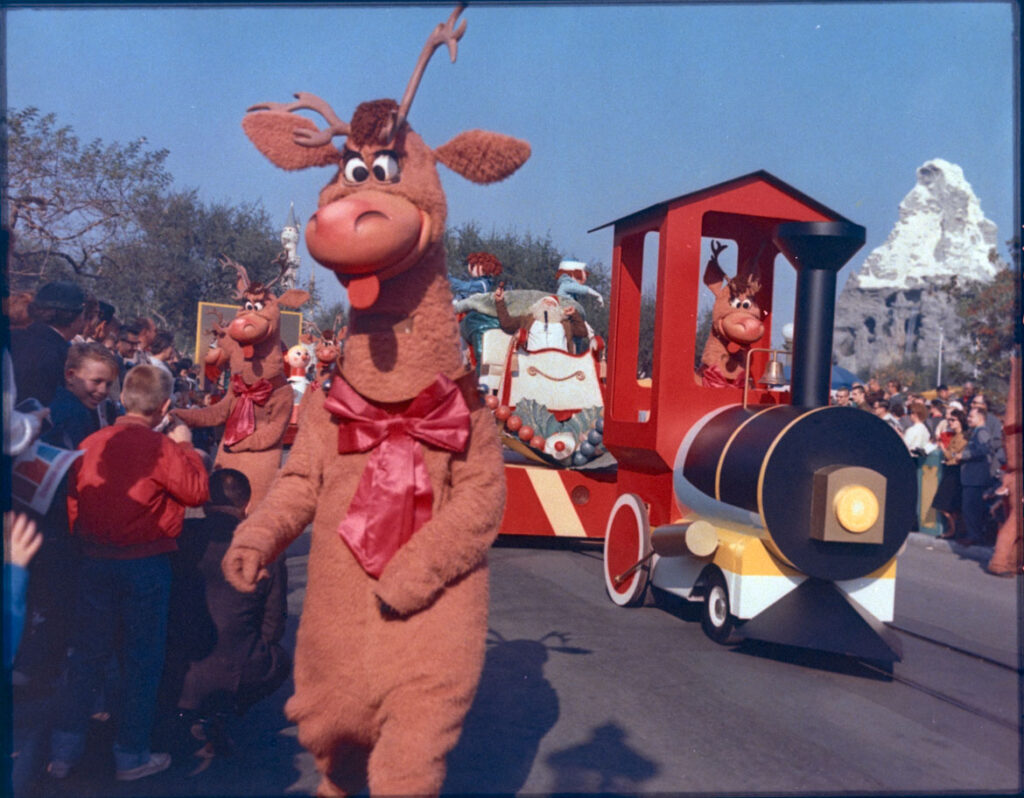 "Christmas Parade at Disneyland, 1986. From ""Holiday Magic at the Disney Parks: Celebrations Around the World from Fall to Winter"" by Graham Allan, Rebecca Cline, and Charlie Price, 2020. (Disney Editions)"