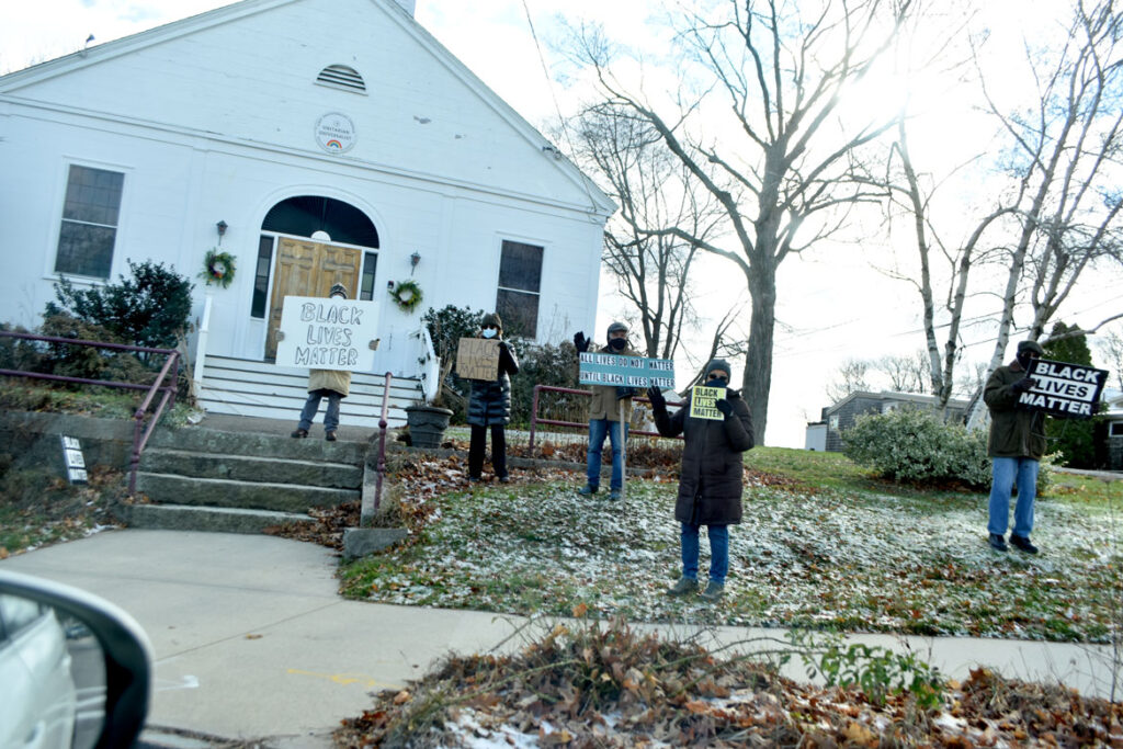 Black Lives Matter activists in front of First Universalist Church of Essex, Dec. 6, 2020. (©Greg Cook photo)