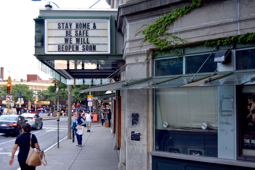 "The Marquee of the Somerville Theatre in Davis Square says ""Stay Home & Be Safe / We Will Reopen Soon,"" July 17, 2020. (©Greg Cook photo)"