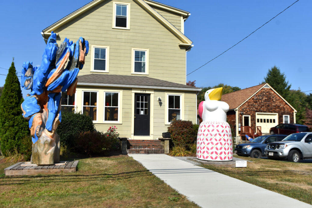 Sculptures by Andy Merlin (left) and Donna Dodson (right) on the lawn of their Summer Street home in Maynard, Sept. 29, 2020. (©Greg Cook photo)