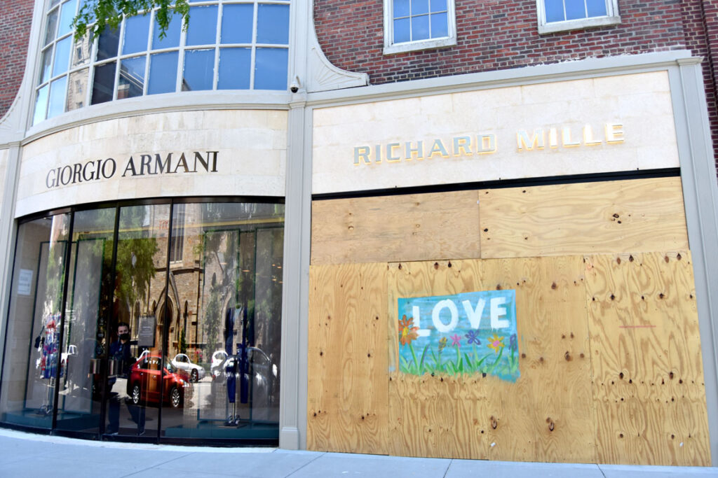 A Newbury Street boutique is boarded up after looting following a Black Lives Matter protest in downtown Boston on May 31, 2020. (©Greg Cook photo)