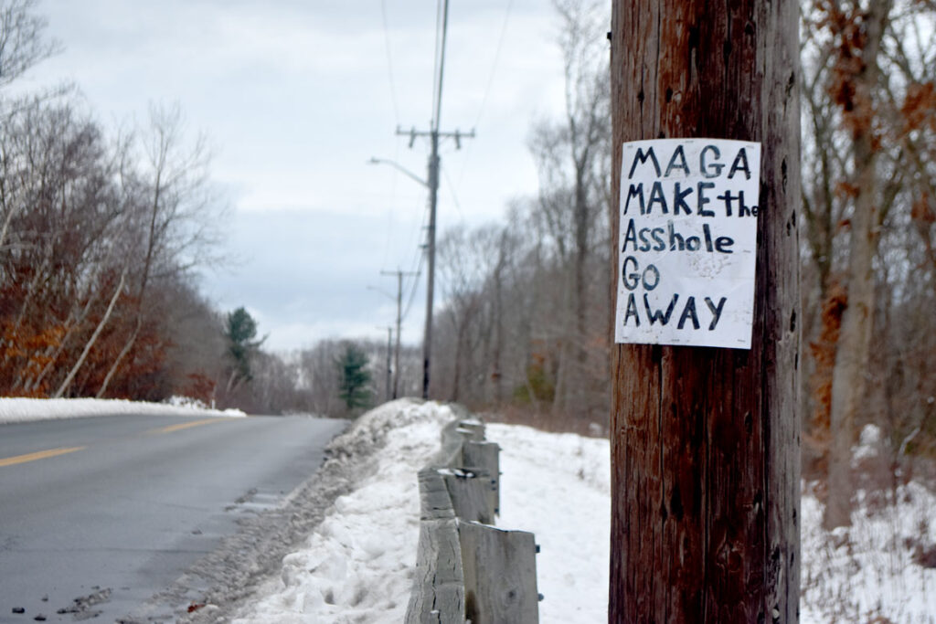 """MAGA Make the Asshole Go Away"" sign at Blackburn Industrial Park, Gloucester, Dec. 20, 2020. (©Greg Cook photo)"